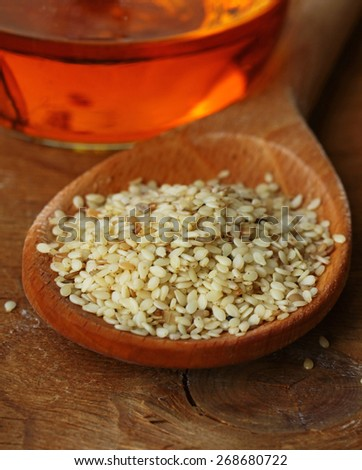 sesame seeds on wooden background macro shot - stock photo