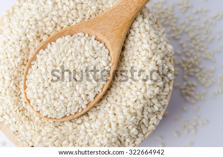 sesame seeds with wooden spoon