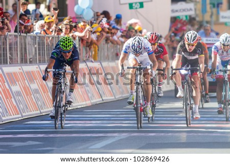 SESTRI LEVANTE, GENOVA, ITALY - MAY 17: Sandy Casar 2nd arrived, Andrey Amador 3rd and Jan Bakelants 4th on the 12th stage of 2012 Giro d'Italia on May 17, 2012 in Sestri Levante, Genova, Italy - stock photo