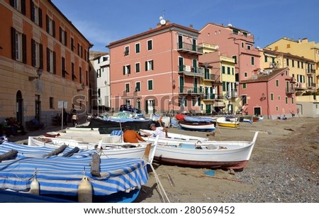 SESTRI LEVANTE, ITALY - NOVEMBER 7: View on Bay of Silence with its fishing boats, colorful buildings and around hills. Sestri Levante, Liguria, Italy - Nov 7, 2014 - stock photo