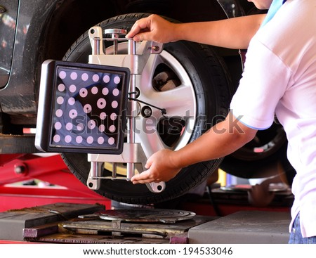 Set against the Center wheel, Wheel Aligner - stock photo