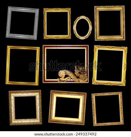 Set antique gold  frame and wooden frame isolated on black background - stock photo