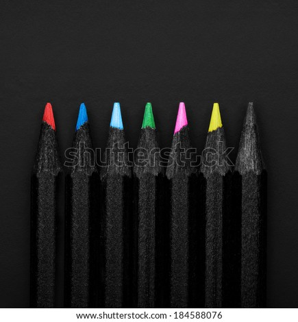 Set beautiful black, colored pencils of colored pencils  on black background - stock photo