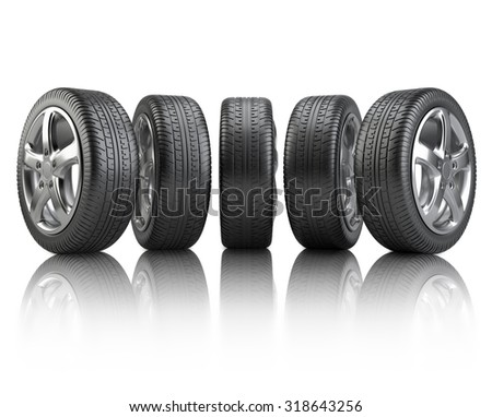 Set car wheels on a white reflective background - stock photo