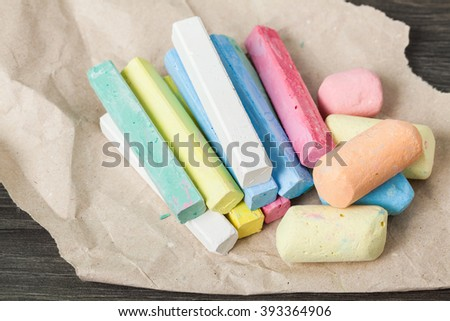 Set colorful chalks on wooden table