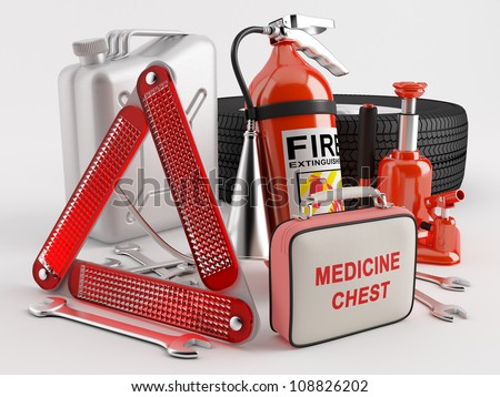 Set consisting of a wheel, fire extinguisher, first aid kit, warning triangle, jack, canister, wrench - stock photo