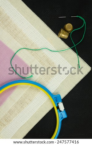 Set for cross stitch. Canvas. Sewing hoop. Needle. Thimble. - stock photo