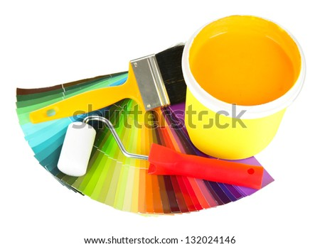 Set for painting: paint pot, brushes, paint-roller and colored palette isolated on white