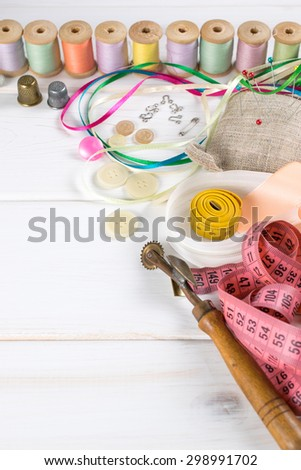 Set for sewing and needlework on a wooden board in Shabby Chic style
