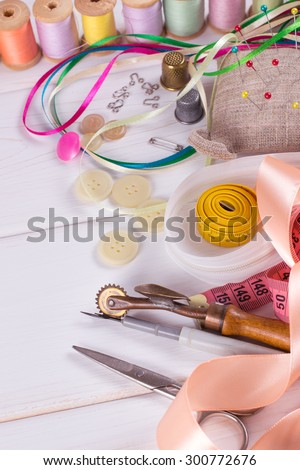Set for sewing and needlework on a wooden board in Shabby Chic style - stock photo