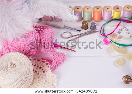 Set for sewing, knitting and needlework on a wooden board in Shabby Chic style - stock photo