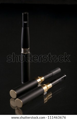 Set for smoking. The electronic cigarette has the big popularity at interested persons to not smoke. - stock photo