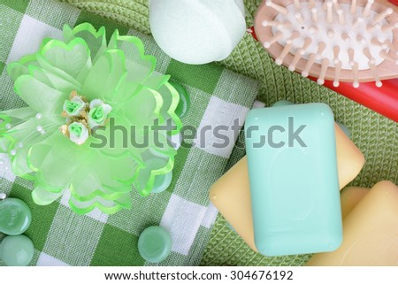 Set for spa, flowers, sea salt, stones, hair brush, soap, aroma candles set Relax and treatment therapy. Summer season.  - stock photo