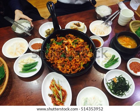 Set fried pork and sauce, Dak galbi, Tak kalbi, Korean food with kimchi when meeting with friend. Top view food on wooden table.