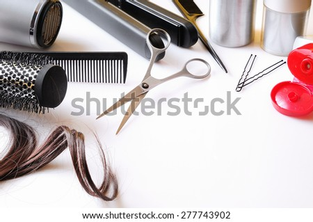 Set hairdressing articles exposed on a white table with room below right to write - stock photo