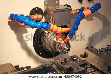 Set in the clamp metal parts for processing on lathe in workshop - stock photo
