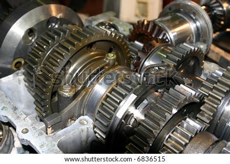 Set linked metal gears the automobile mechanism in plentiful greasing - stock photo
