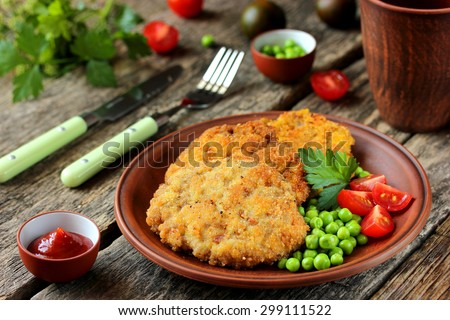 Set lunch: steaks with a crispy crust and vegetable garnish - stock photo
