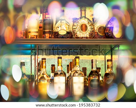 Set of Alcohol bottles on the wall with Bokeh - stock photo