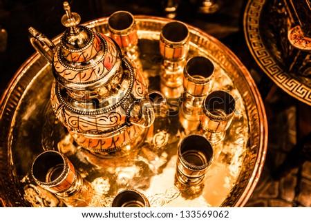 Set of arabic nana mint tea with metal tea pot and glasses - stock photo