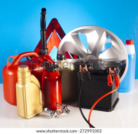 Set of auto parts, car battery on vivid moto concept - stock photo