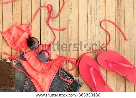 Set of Beach Clothes Pink Bikini Flip Flops Glasses Summer Holiday Concept - stock photo