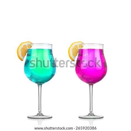 Set of beautiful shot glasses filled with colored alcoholic cocktails - stock photo