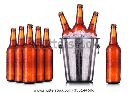 Set of beer's bottles with frosty drops in ice isolated on white background - stock photo