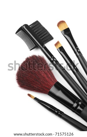 Set of black make-up brushes on white background.