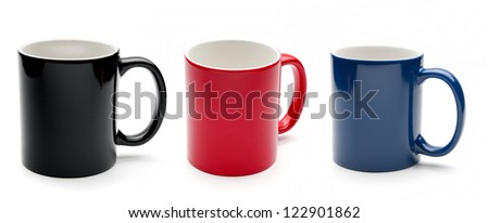 Set of black, red and blue cups on a white background - stock photo