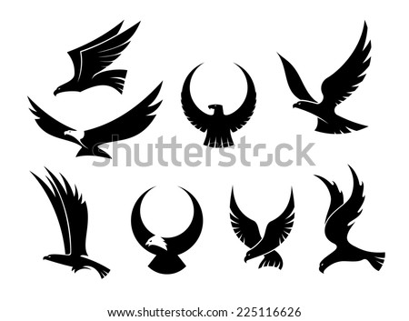 Set of black silhouettes of graceful flying eagles with their outspread wings for heraldry and hunting design - stock photo