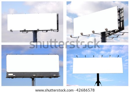 Set of 4 blank big billboards over blue sky, put your own text here - stock photo