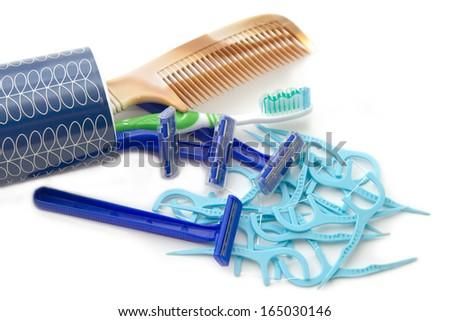 Set of body care for men,toothbrush,dental floss pick,shaving razor and comb - stock photo