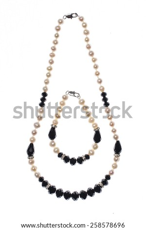 set of bracelet and beads on white background
