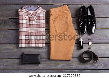 Set of brown men's clothing and accessories. - stock photo