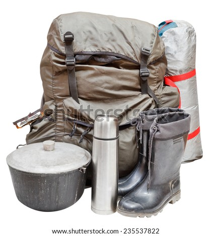 set of camping equipment with backpack, tent, pot, rubber boots, thermos, gas burner isolated on white background - stock photo