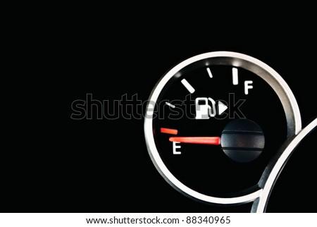 Set of car dash boards petrol meter, fuel gauge, on black background - stock photo