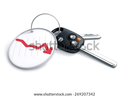 Set of car keys with key ring and graph showing decline in vehicle sales. Concept for falling car prices, buyer or selling a vehicles. Automotive stock market performance, shares, stocks and bonds.