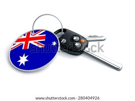 Set of car keys with keyring and country flag. Concept for car prices, buyer or selling a vehicle in Australia. Vehicles made and produced in Australia. Australian vehicle brands.