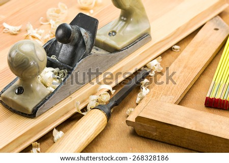 Set of carpenter??s working tools: plane, chisel, square, folding rule - stock photo