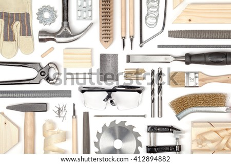 set of carpentry tools on white background. carpenter working table. carpentry and woodwork industry flat lay concept top view - stock photo