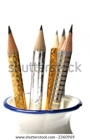 Set of celebratory sparkling pencils standing in a vase 1