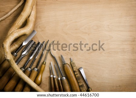 Set of chisels for woodcarving. Wooden background - stock photo