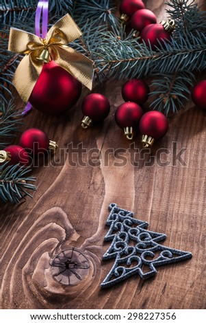 set of christmas toys on vintage wood board. - stock photo