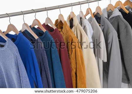 Set of clothes of different men's coat ,jacket on wooden hangers