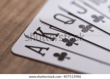 Set of Clubs suit playing cards on wooden desk - stock photo