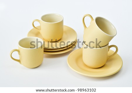 Set of coffee cups and saucers over white