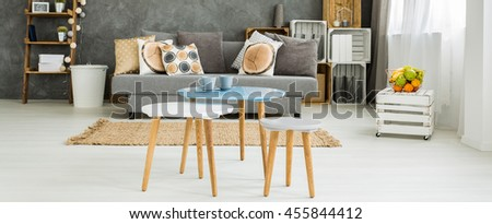 Set of coffee tables with cups of coffe in a cosy and functional apartment