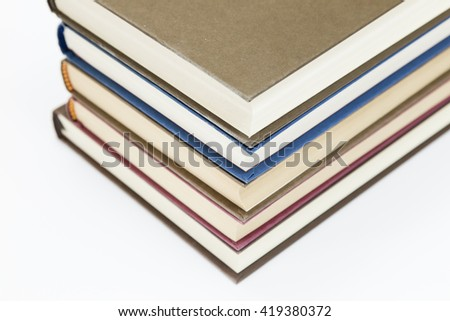 set of color books stacked on a white background