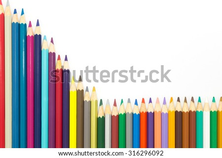 Set of color pencils on white background, multiple colors - stock photo